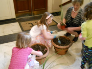 Planting flowers for the urns outside of the church porch