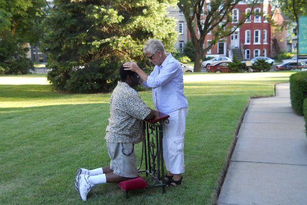 Barbara offering healing prayers
