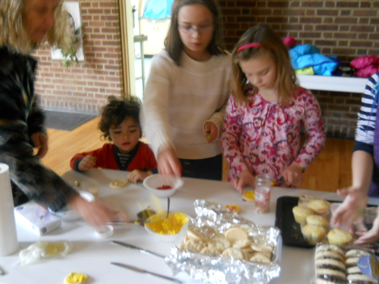 Decorating cookies for the Albany Damien Center with the children from St. John's Lutheran Church